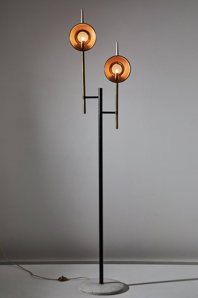 Rare floor lamp designed in the style of  Angelo Lelli for Arredoluce in Italy, circa 1950s. Enameled metal, brass, glass diffusers with marble base. Original cord with step switch. Each shade takes one E14 60w maximum bulb.