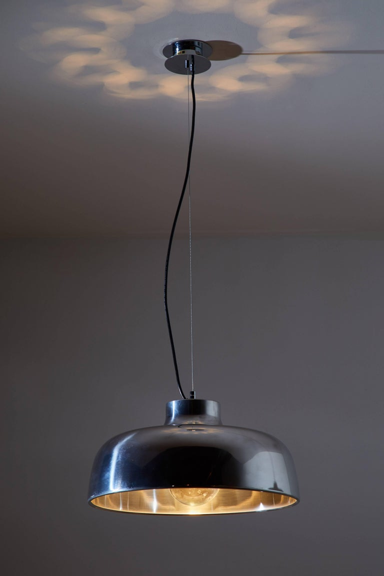M68 suspension light by Miguel Milá for Santa & Cole originally designed in 1962. This re-edition is currently manufactured in Barcelona, Spain. The hugely evocative shade on the M68 lamp immortalizes the silhouette of a woman's shoulders. It is an