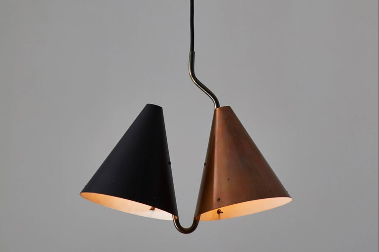 Rare double pendant lamp designed by Svend Aage Holm Sørensen, manufactured by Lyfa in Denmark in 1955. Enameled steel and copper plated brass. Wired for US junction boxes. Custom brass canopy. Takes two E-27 75w maximum bulbs