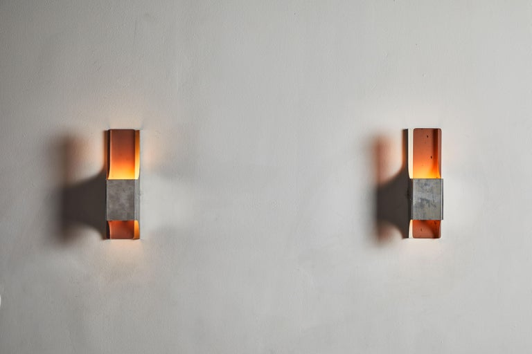 Three sconces designed and manufactured in France, circa 1970s. Stainless steel and tinted acrylic. Rewired for US junction boxes. Each light takes one E27 60W maximum bulbs per sconce. Sold and priced individually.