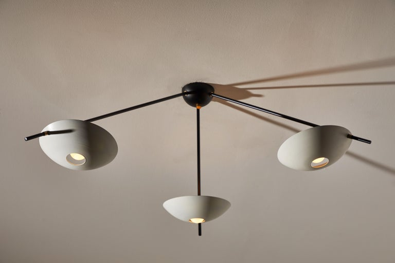 Three-arm flush mount ceiling light. Manufactured in Italy, circa 1950s. Enameled metal, brass fittings. Rewired for US junction boxes. Original canopy Takes three 60w maximum European candelabra bulbs.