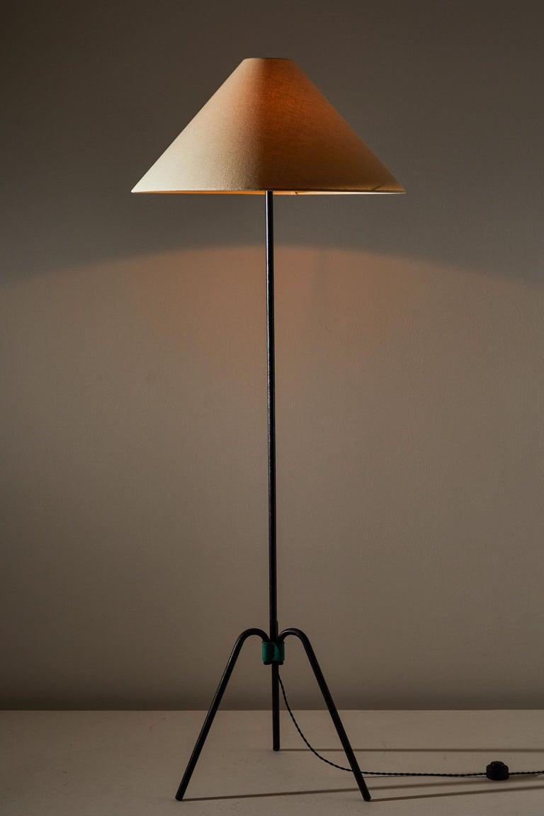 Floor lamp designed and manufactured in France, circa 1950s. Iron base, custom linen shade. Rewired with French twist cord. Takes one E27 75w maximum bulb.