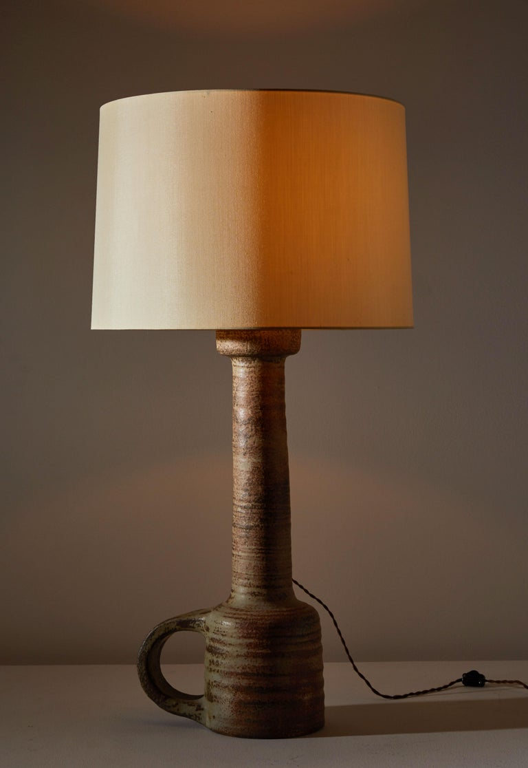 Table lamp manufactured by Mobach in the Netherlands, circa 1960s. Glazed ceramic. Silk shade not included. Rewired with brown french twist cord. Takes one E27 75w maximum bulb. Retains original manufacturer's mark.