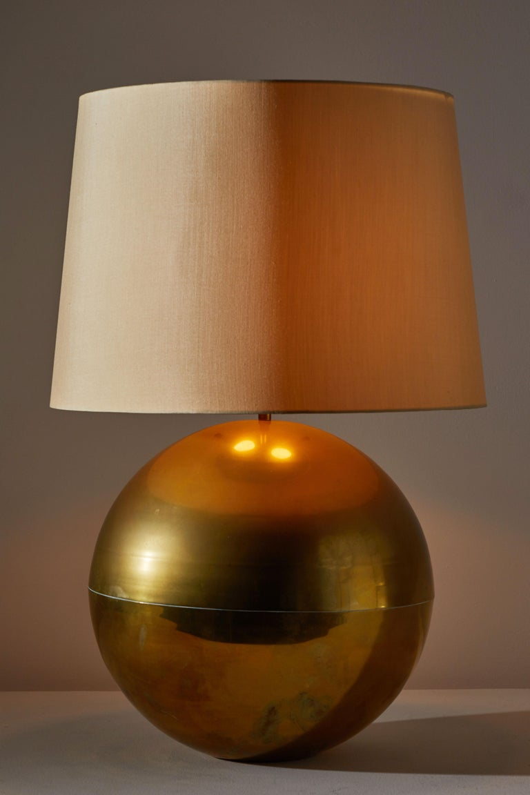 Table lamp by Karl Springer. Designed and manufactured in the US circa 1980s. Brass with silk shade. Shade not included. Original cord. Takes one E26 75w maximum bulb. Height displayed is from base of light to of finial.