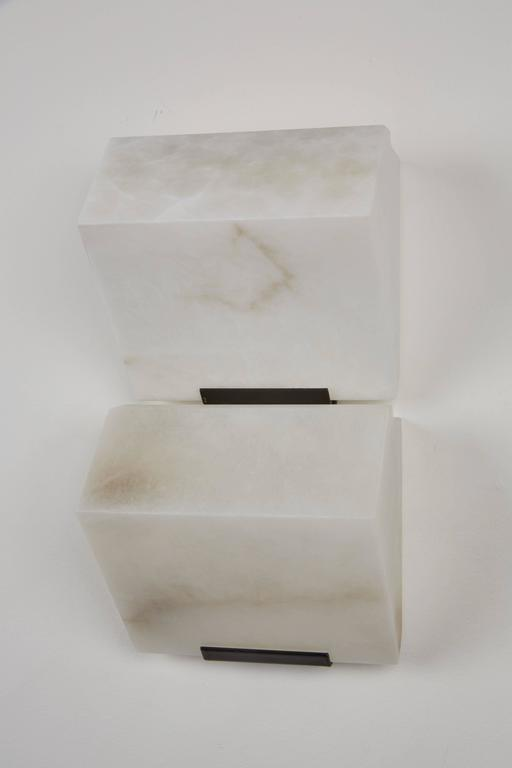 Originally designed in 1923 this current production by Galerie MCDE of France of the double sloping wall lamp by Pierre Chareau is composed of two blocks of alabaster. Blocks  This wall lamp is also available in single, double or triple blocks.
