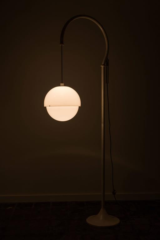 Rare extra large sizes floor lamp designed by Luigi Bandini Buti designer for Kartell in 1965. Lacquered metal, acrylic. Height of globe can be adjusted by pulley. Original cord. Takes one E27 100w maximum bulb.