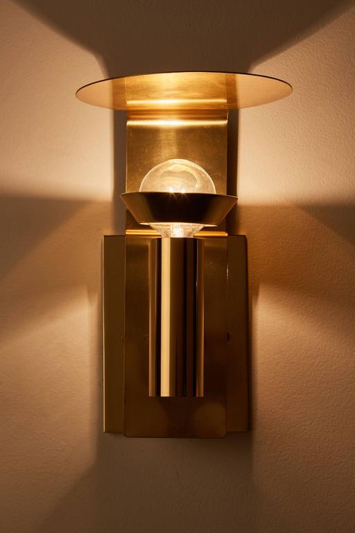 Four brass sconces manufactured by Focus Design in Sweden, circa 1960s. Wired for US junction boxes. Each sconce takes one E27 75w maximum bulb.