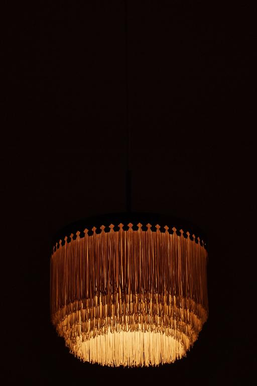 Brass and silk cord pendant by Hans-Agne Jakobsson for Markaryd, Sweden, circa 1960s. E27 40 W maximum bulb. Overall drop can be customized. Wired for US junction boxes.