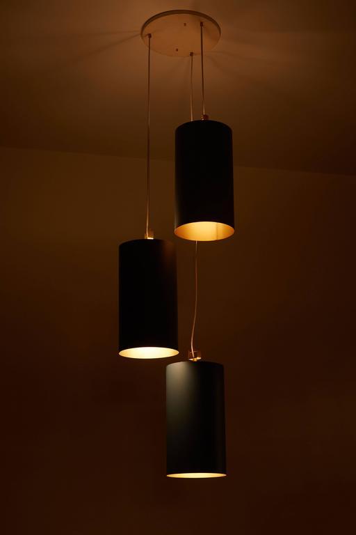 Twenty Three Cylindrical Shades by Louis Poulsen 2