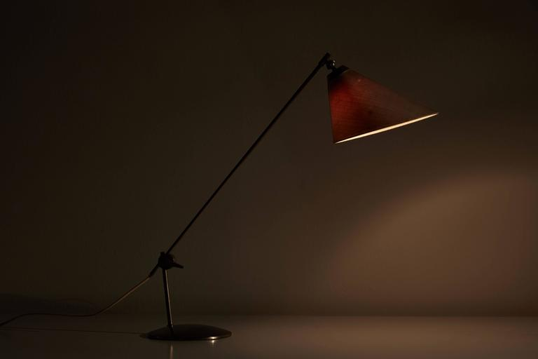 Rare articulating table lamp with original linen shade. Designed in Denmark, circa 1960s. Satin nickel plated brass. Adjustable arm and articulating shade. Original cord. Takes one E27 60w maximum bulb.