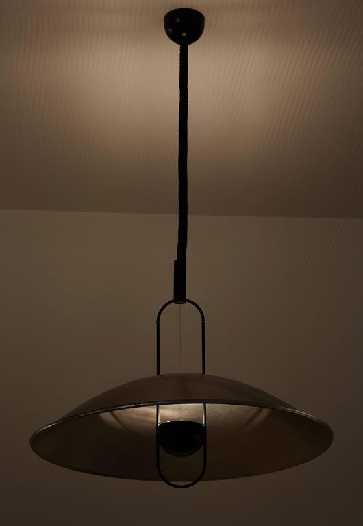Macumba pendant light by Ernesto Gismondi for Artemide designed in Italy, 1974. Perforated metal and brass. Wired for US junction boxes. Takes one E27 100w maximum bulb.
