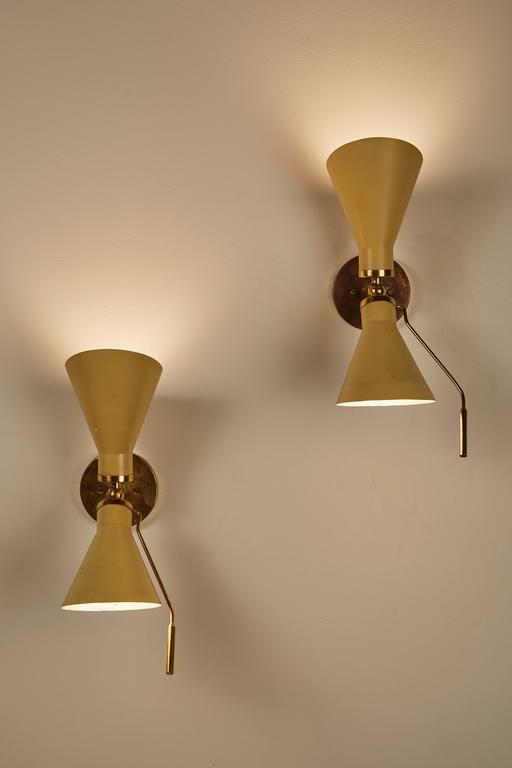 Pair of Model 131 articulating sconces by Gino Sarfatti designed in Italy, circa 1950s. Original backplates. Wired for US junction boxes. Each sconces takes an E14 75w maximum European candelabra. Literature: Gino Sarfatti Selected Works 1938-1973