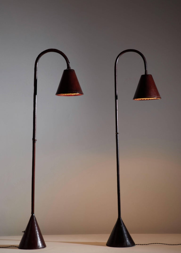 Leather wrapped floor lamp by Jacques Adnet designed in France, circa 1950s.
