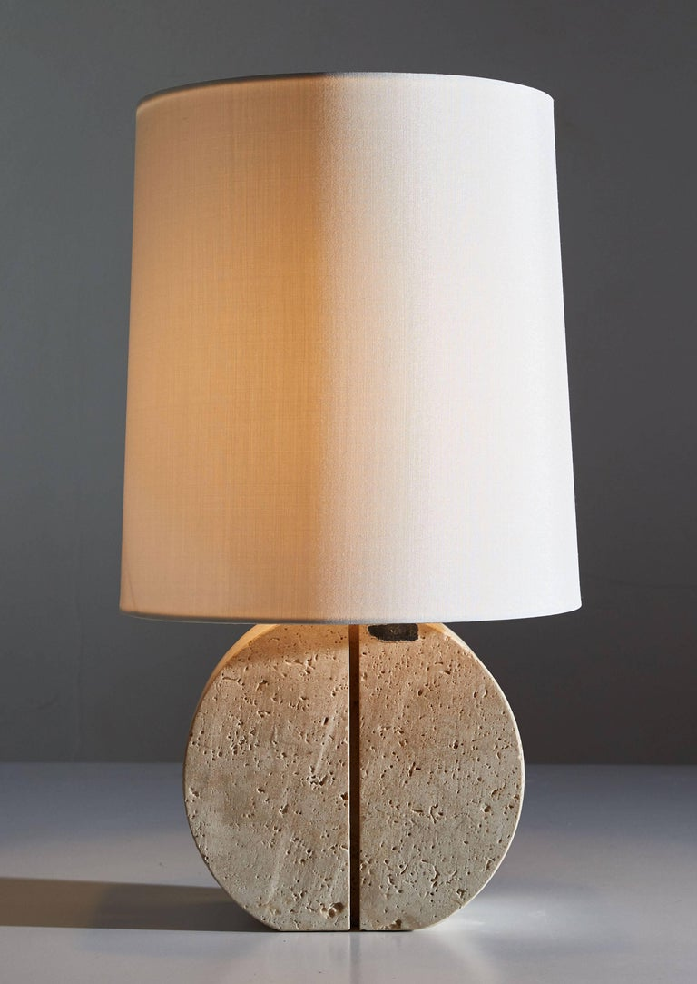 Travertine table lamp designed in Italy, circa 1970s. Linear carving to front and sides of travertine. Custom silk shade. Original cords. Maintains original label. Takes one E27 75w maximum bulb