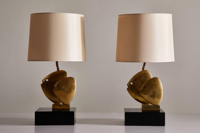 Pair of solid cast brass table lamps. Designed in France, circa 1970s. Solid cast brass-mounted to lacquered wood base. Custom silk shades included. Rewired with black French twist silk cord. Each light takes one E26 75w maximum bulb.