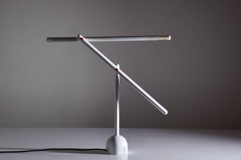 Articulated Mira table lamp by Mario Arnaboldi designed in Italy, circa 1980s. Enameled metal and aluminum construction with pivoting head. Original cord. Takes one G9 halogen bulb. Original finish. Original manufacturers label. Dimensions are