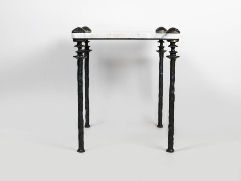 Two marble-topped small scaled side tables. The legs are cast bronze.