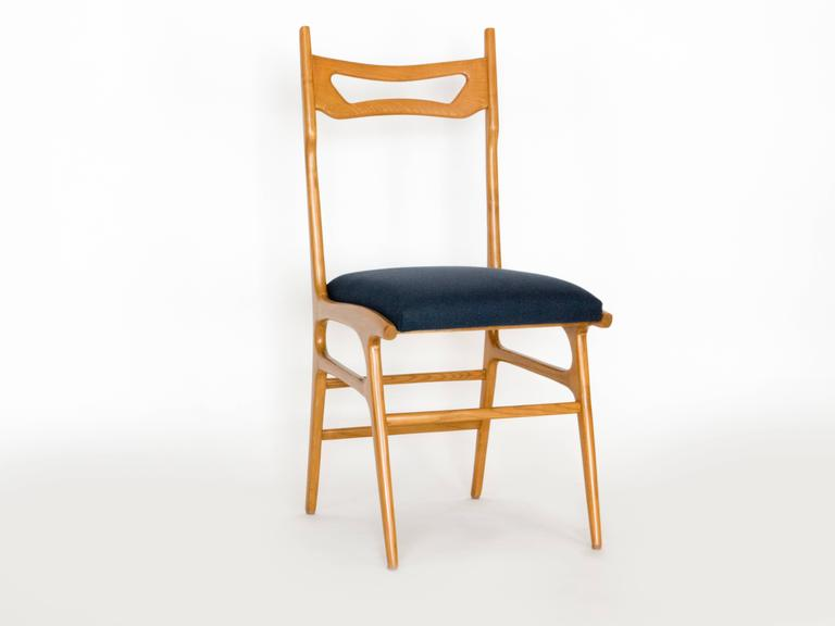 Six exquisite elm side chair by Vittorio Vago Mobili. In great condition, The frames have been refurnished and a charcoal fabric applied. Very Mid-Century Italian!