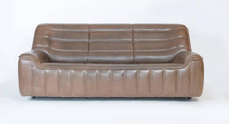 Three-seat leather sofa by De Sede. The couch is in perfect condition. It has a great patina. Very comfortable and rare to find a three-seat of this model.  This sofa is in our space in the Gallery @ 200 Lex. in  NYC.
