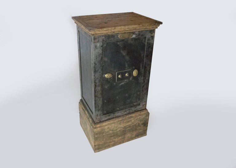 This mid sized steel safe is in perfect working condition. The two tumbler combination lock along with the key system has two beautiful decorative brass elements to hide the key holes. Inside the safe also has a keyed jewelry box and an adjustable
