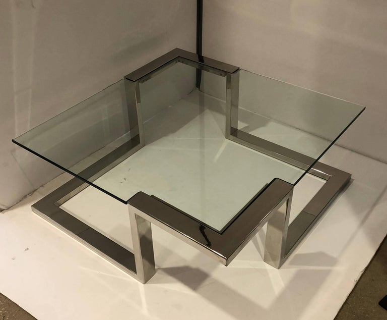 This sleek designed coffee table intricate cut-glass top on a chrome base. Unique design.