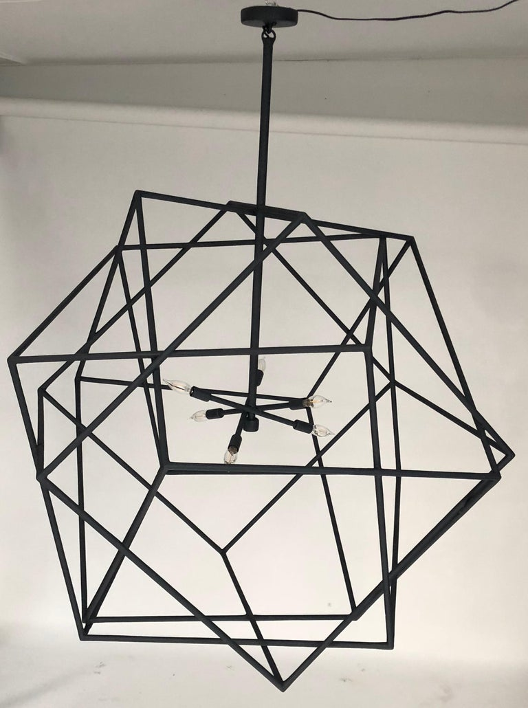 This geometric cubic chandelier is a blend of three cubes which are intertwined.
