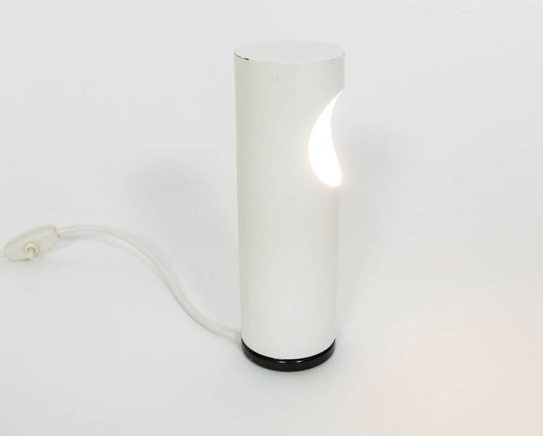 Ecolight Milano tube lamp. This original table lamp by Gaetano Scolari provides ambience light. Lamp is in our NYC showroom in the New York Design Center.