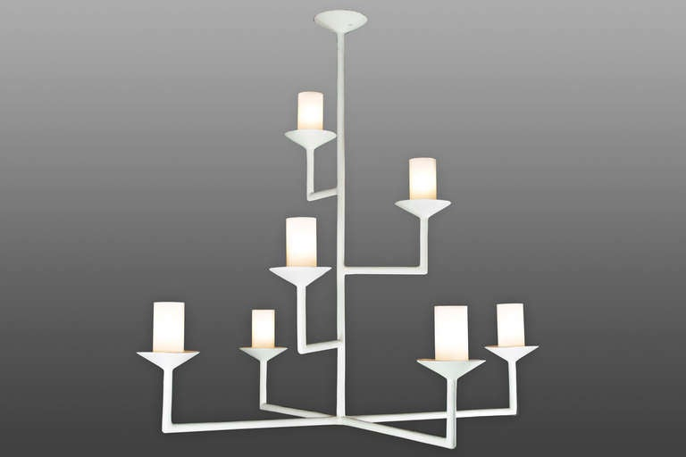 Seven-arm chandelier with a plaster of Paris finish. Glass tubes with white and clear fret conceal the light bulbs.
