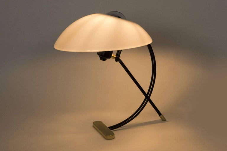 This stylish table lamp is a nice blend of the basic midcentury elements, brass, acrylic and black enamel. This midcentury inspired lamp provides a beautiful light. The details of the frame add to the elegance. Light uses on medium based bulb.