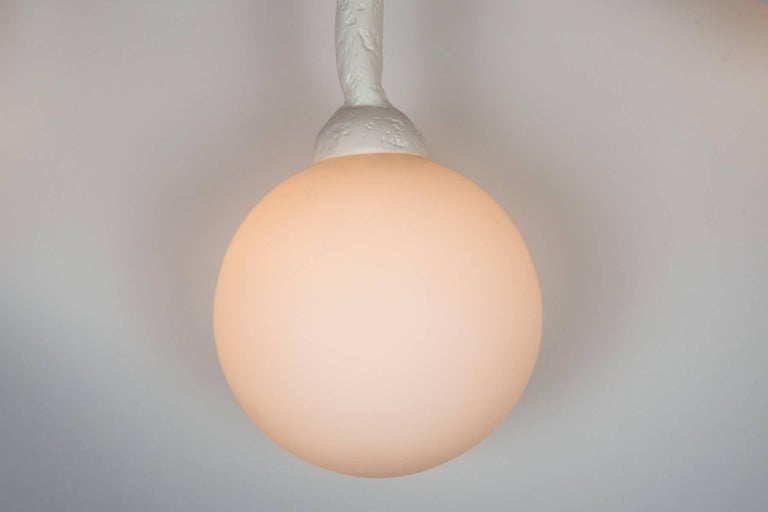 This unique chandelier has a plaster of Paris finish on it organic design frame. The light has 16 opaline glass diffusers. Light uses 16 candelabra base bulbs. Max wattage 40 each socket. Light is in our NYC Showroom in the New York Design Center.