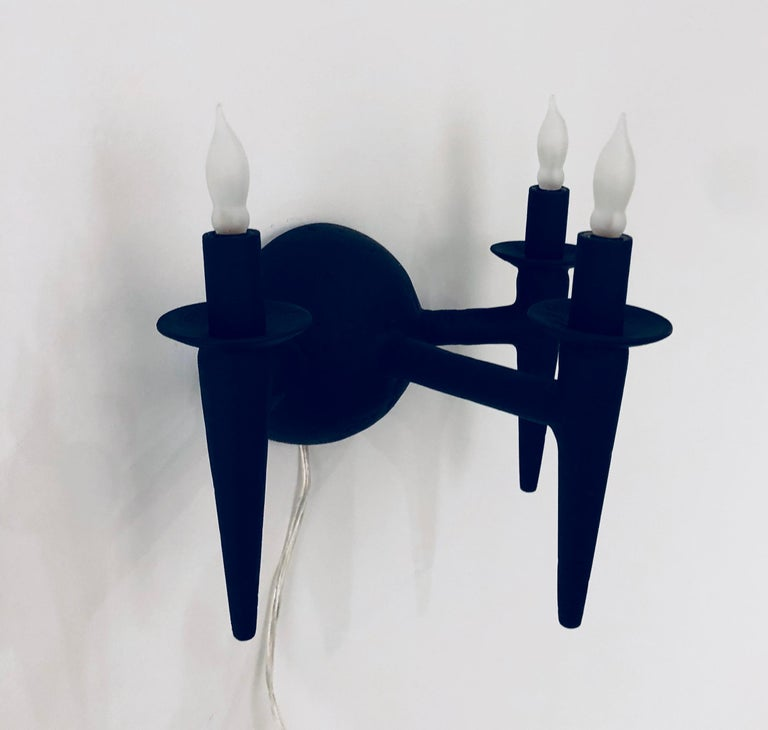 Two wall sconce with plaster finish. Fixture uses three candelabra based bulbs, Max wattage 60 each. Lights fits on a standard J box. The sconces have a custom matte black finish. Custom sconces can have custom paint finishes specified. Sconces are