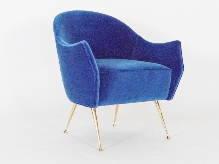 Two stylish side chairs with cast brass legs and a distinctive curved back. The chairs are very comfortable, perfect in size and are ideal as small- scale side chairs. The beauty of the tapered legs with their graceful, feet are sure to add that