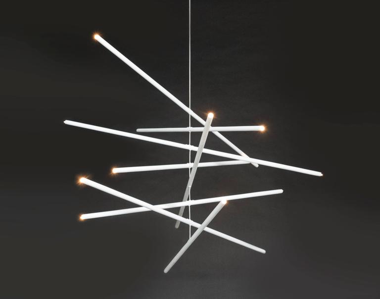 This intriguing chandelier floats in the air like a mobile. The hand finished plaster rods are fitted with low voltage halogen sockets and are suspended from a woven stainless steel wire. The sixteen lights provide a perfect ambience and light the