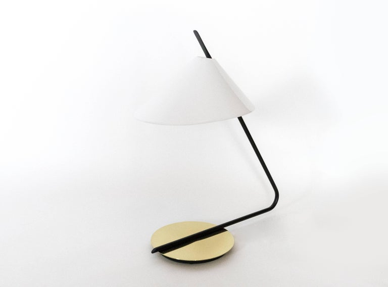 This lamp was scaled to work perfectly as a desk lamp, bedside lamps, or on an end tables. The soft light which is diffused by the acrylic shade is accented by the reflection from the brass base.