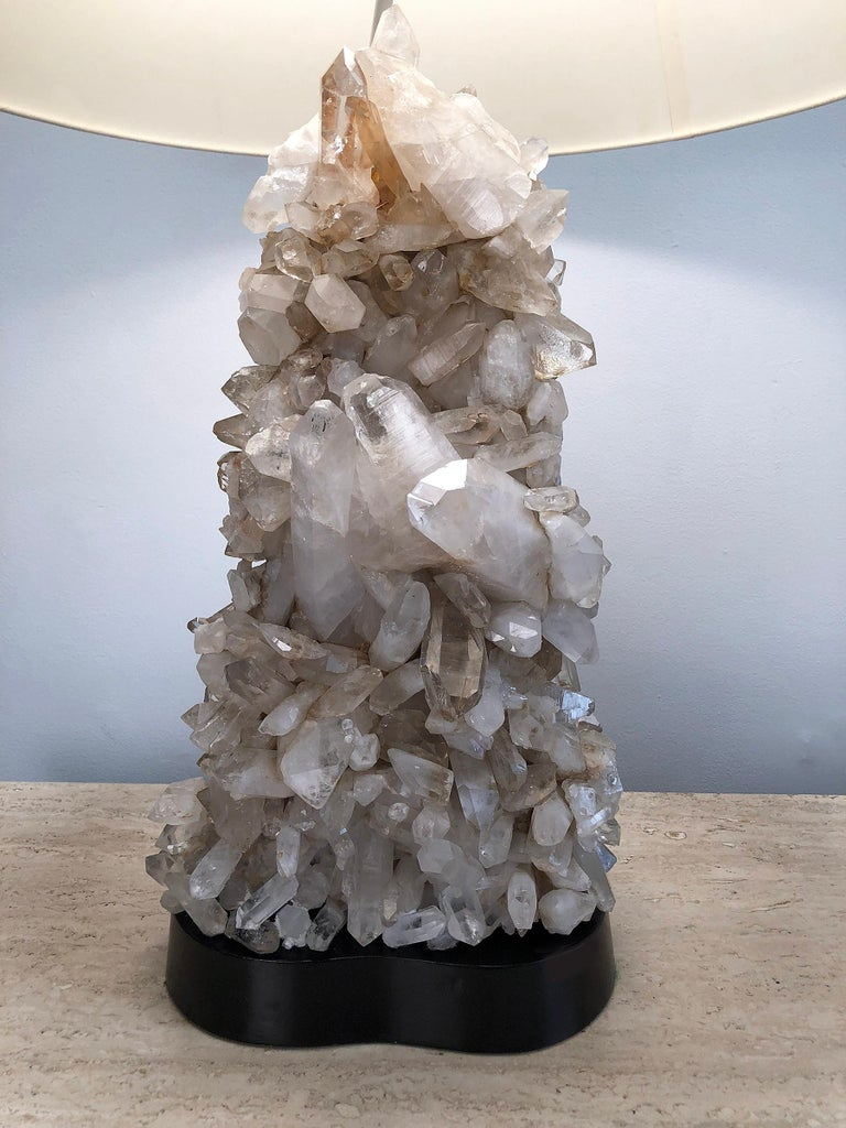 Handcrafted quartz crystal table lamp by Carole Stupell. Base is lacquered wood. Retains original quartz crystal finial. 