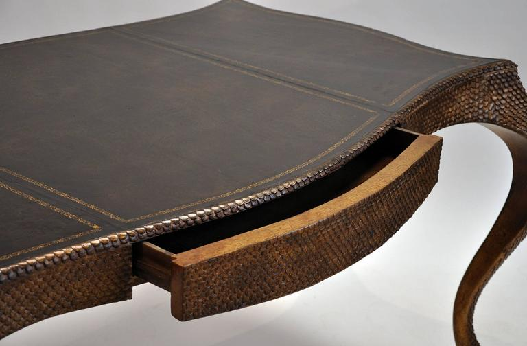 Beautiful leather top desk with gold embossed details. Base has an antique gold scale finish. Features one drawer. Made in America by Ferguson Copeland Ltd.