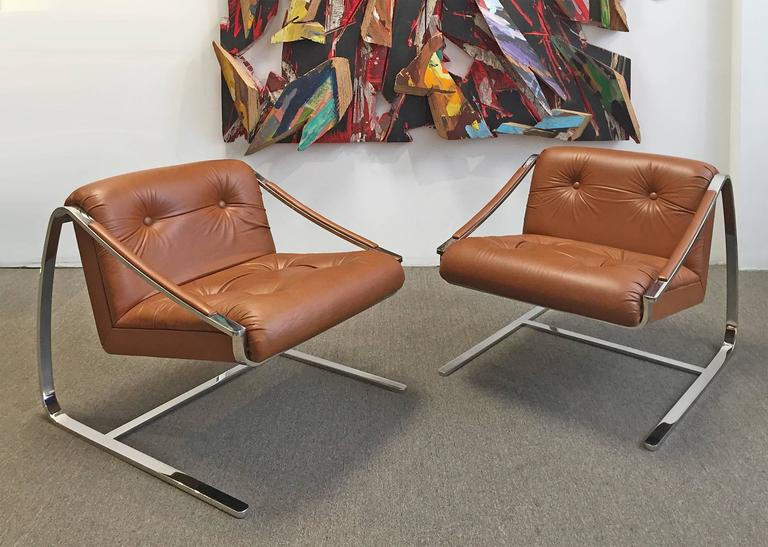 "Exceptional pair of heavy polished steel and leather ""Plaza"" lounge chairs. Made by Brueton Furniture. Designed by Charles Gibilterra. Ultra modern style. Designed for comfort. Fresh and ready for use. Price is for the pair."