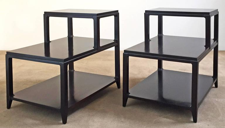 Pair of Mid-Century Modern lacquered step tables. Finish has been restored. Price is for the pair.
