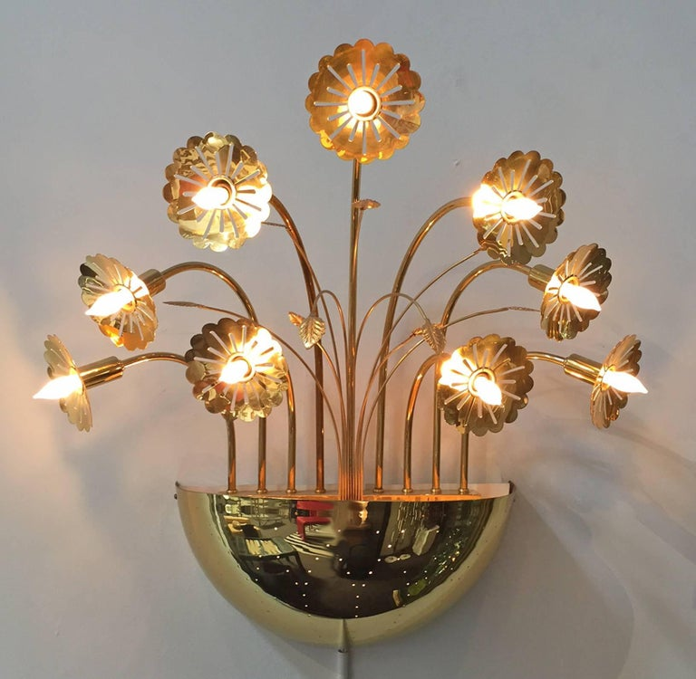Wall light designed by Finnish modern master of lighting: Paavo Tynell. 