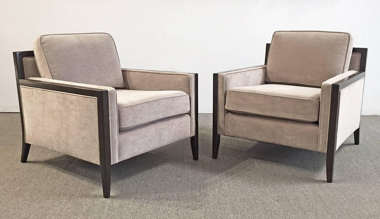 Modern pair of upholstered chairs with stained wood frame. Newly upholstered and restored. Price is for the pair.