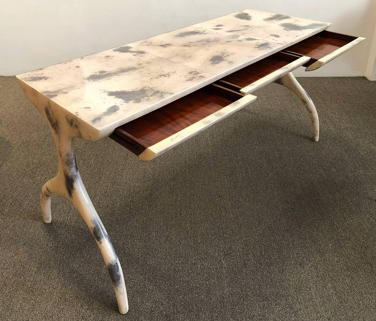 Parchment (leather) clad table with three drawers. Use as a console table, desk, or both. Clad in goatskin with a durable clear finish.