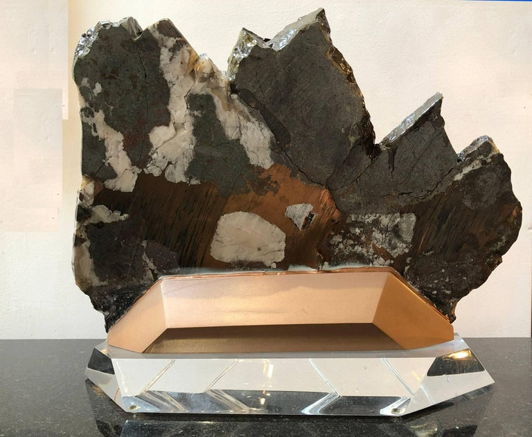 Mineral specimen that has been polished and custom mounted on Lucite.