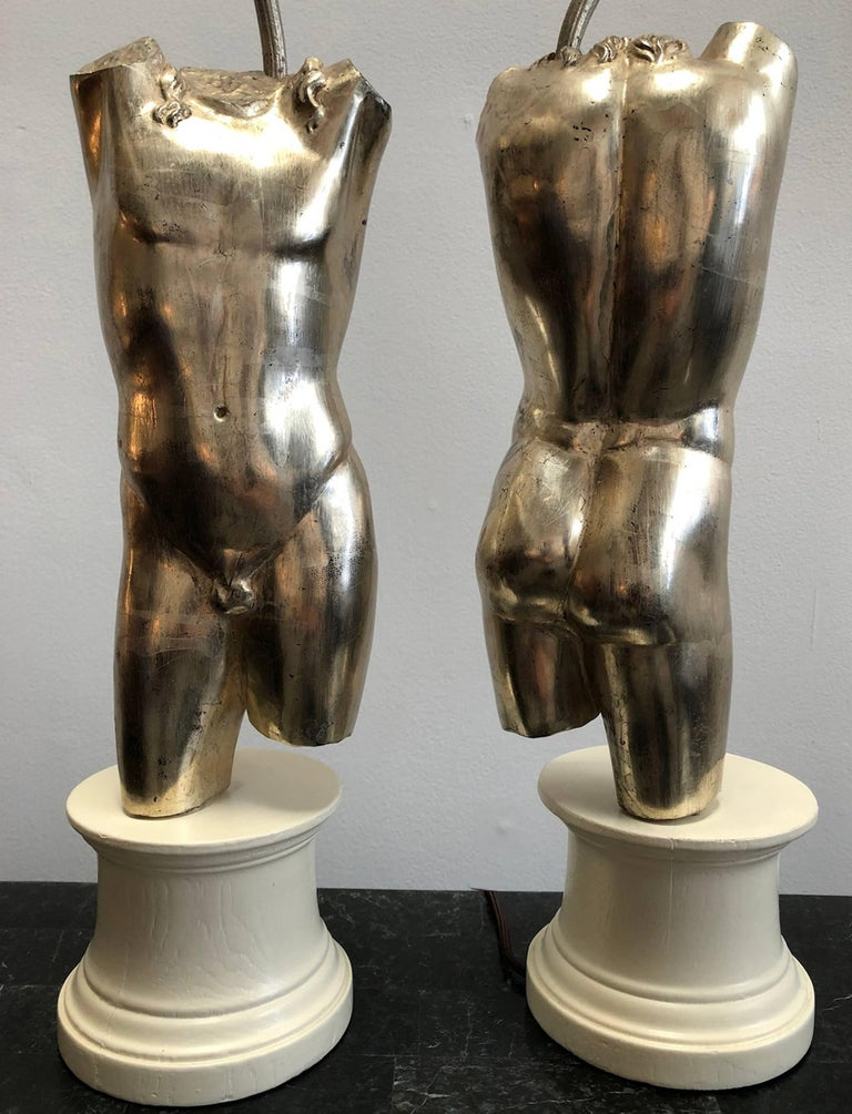 Pair of male torso lamps. Lacquered wood bases. Silver patinated finish. Classic look from the 1960s.