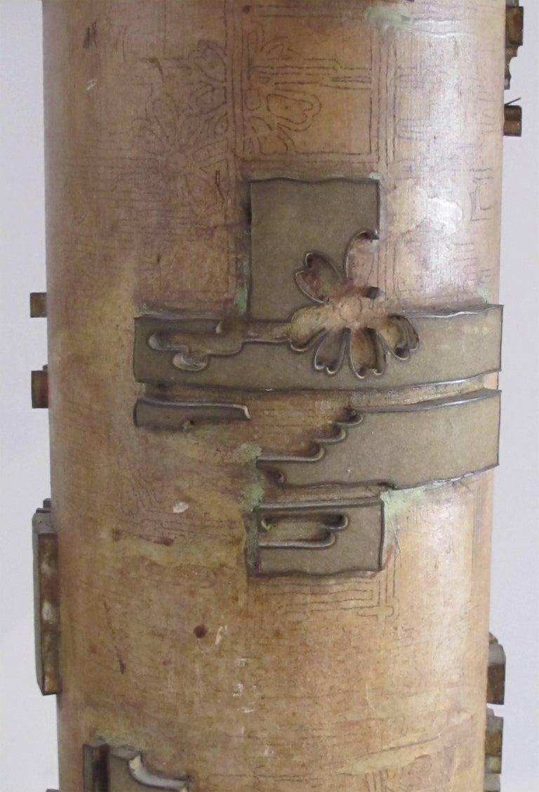 A well-crafted pair of French art deco wall paper roller lamps with solid brass caps and bases; each wooden cylindrical roller with applied hand-carved geometric and stylized floral motifs re-purposed as lamps; originally used for hand-printed wall