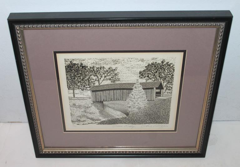 This amazing etching of a covered bridge in Cream Ridge, New Jersey. It is in upper Freehold Township in Monmouth County, New Jersey. This is a big farmland area. This is signed by the artist Chris Maria and numbered 77. The detail and the work is