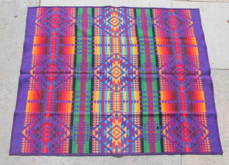 This fine multicolored wool camp blanket is in great as found condition. The original label is on the lower right hand corner of the blanket. These colors are very hard to find in these camp blankets.