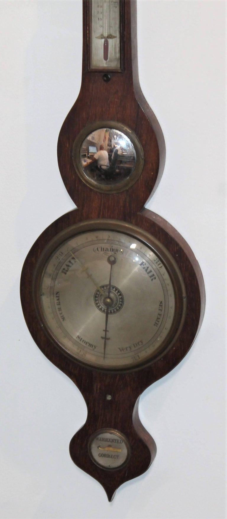 Wheel or banjo barometer. Original mercury glass mirror. All original, small glass shell is missing from the top.