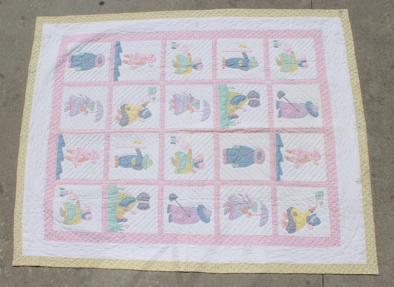 This fun and folky kids applique quilt shows the girls and boys walking in the rain, planting flowers and many other activities. The condition is pristine and the quilting and applique work is very good.