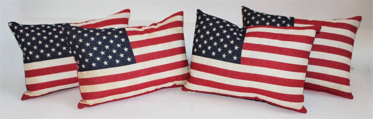 Flag pillows with fifty star flags and blue and red cotton linen backings. The inserts are down and feather fill.