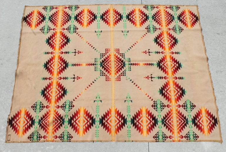 This fine early 1909 Cayuse blanket is in fine condition with binding edge wear and fragments of original label. This blanket has different pattern and color on both sides.